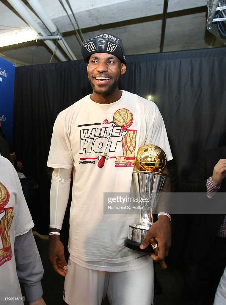 LeBron James #6 of the Miami Heat holds the Bill Russell NBA Finals Most Valuable Player Award as he celebrates defeating the San Antonio Spurs in Game Seven of the 2013 NBA Finals on June 20, 2013 at American Airlines Arena in Miami, Florida.