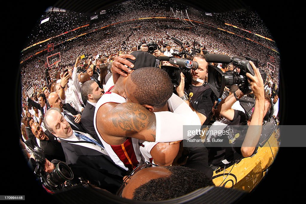 <a gi-track='captionPersonalityLinkClicked' href=/galleries/search?phrase=LeBron+James&family=editorial&specificpeople=201474 ng-click='$event.stopPropagation()'>LeBron James</a> #6 of the Miami Heat hugs teammate <a gi-track='captionPersonalityLinkClicked' href=/galleries/search?phrase=Dwyane+Wade&family=editorial&specificpeople=201481 ng-click='$event.stopPropagation()'>Dwyane Wade</a> #3 of the Miami Heat after defeating the San Antonio Spurs in Game Seven of the 2013 NBA Finals on June 20, 2013 at American Airlines Arena in Miami, Florida.