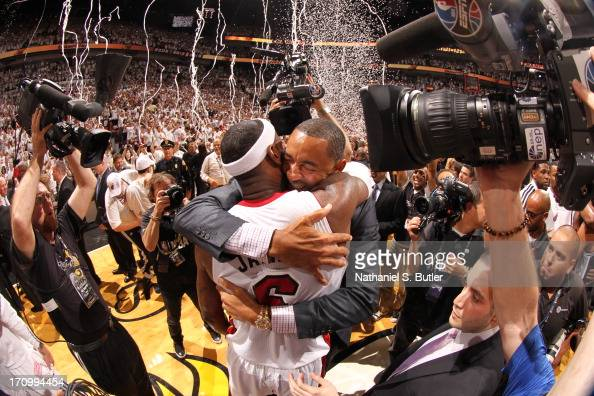 LeBron James of the Miami Heat hugs teammate Juwan Howard of the Miami Heat after defeating the San Antonio Spurs in Game Seven of the 2013 NBA...