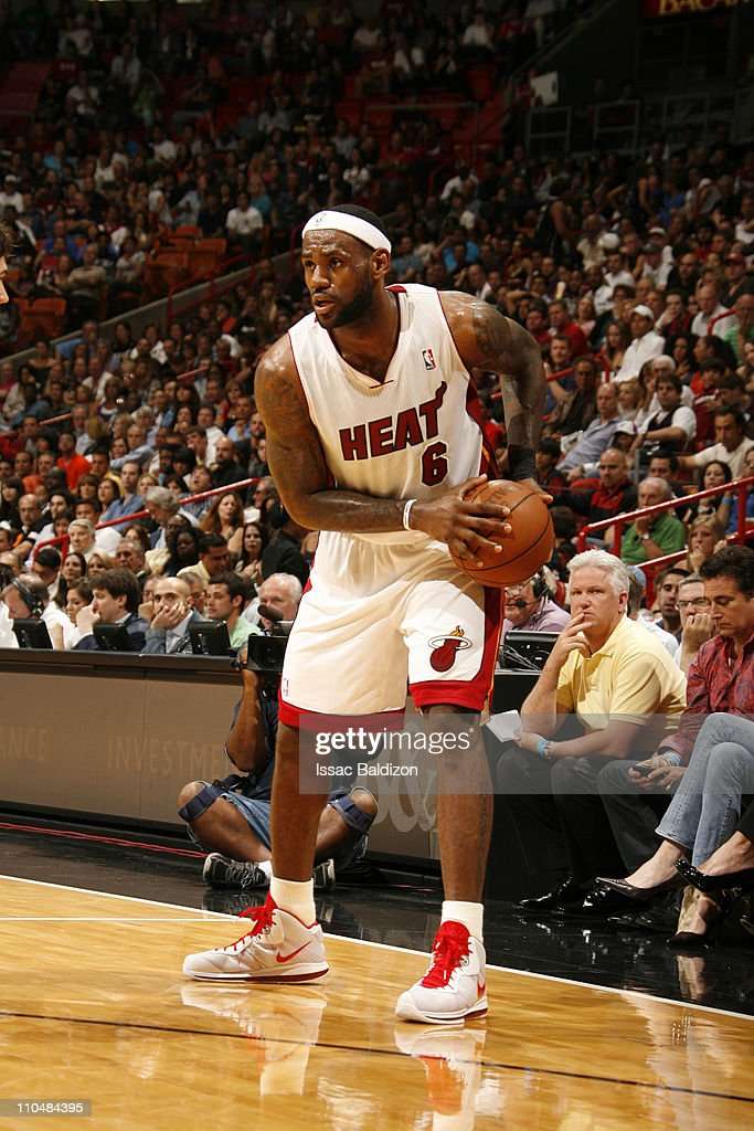 <a gi-track='captionPersonalityLinkClicked' href=/galleries/search?phrase=LeBron+James&family=editorial&specificpeople=201474 ng-click='$event.stopPropagation()'>LeBron James</a> #6 of the Miami Heat in action against the Denver Nuggets on March 19, 2011 at American Airlines Arena in Miami, Florida.