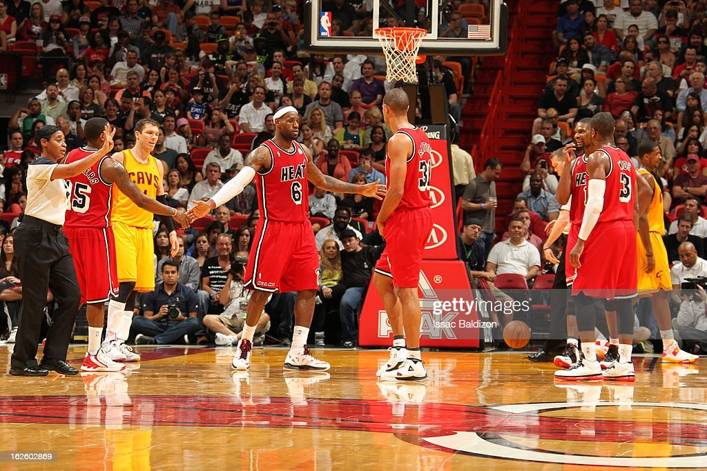 <a gi-track='captionPersonalityLinkClicked' href=/galleries/search?phrase=LeBron+James&family=editorial&specificpeople=201474 ng-click='$event.stopPropagation()'>LeBron James</a> #6 of the Miami Heat is congratulated by teammates during a game between the Cleveland Cavaliers and the Miami Heat on February 24, 2013 at American Airlines Arena in Miami, Florida.