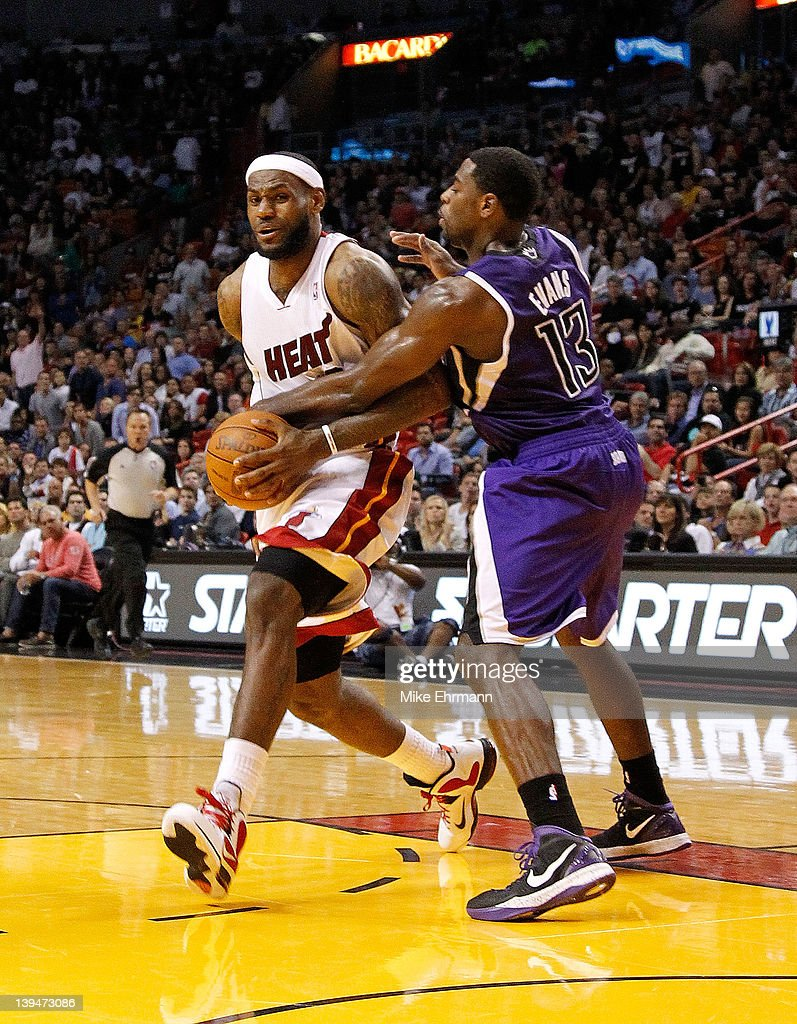 <a gi-track='captionPersonalityLinkClicked' href=/galleries/search?phrase=LeBron+James&family=editorial&specificpeople=201474 ng-click='$event.stopPropagation()'>LeBron James</a> #6 of the Miami Heat is fouled by <a gi-track='captionPersonalityLinkClicked' href=/galleries/search?phrase=Tyreke+Evans&family=editorial&specificpeople=4851025 ng-click='$event.stopPropagation()'>Tyreke Evans</a> #13 of the Sacramento Kings during a game at American Airlines Arena on February 21, 2012 in Miami, Florida.