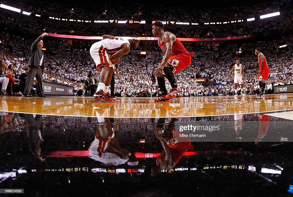 <a gi-track='captionPersonalityLinkClicked' href=/galleries/search?phrase=LeBron+James&family=editorial&specificpeople=201474 ng-click='$event.stopPropagation()'>LeBron James</a> #6 of the Miami Heat is guarded by <a gi-track='captionPersonalityLinkClicked' href=/galleries/search?phrase=Jimmy+Butler+-+Basketballer&family=editorial&specificpeople=9860567 ng-click='$event.stopPropagation()'>Jimmy Butler</a> #21 of the Chicago Bulls during Game Five of the Eastern Conference Semifinals of the 2013 NBA Playoffs at American Airlines Arena on May 15, 2013 in Miami, Florida.