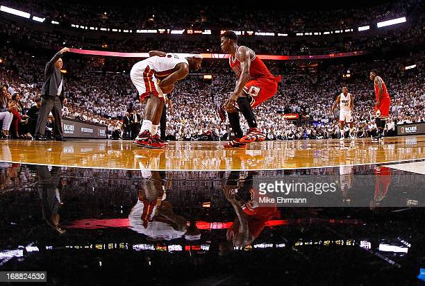 LeBron James of the Miami Heat is guarded by Jimmy Butler of the Chicago Bulls during Game Five of the Eastern Conference Semifinals of the 2013 NBA...