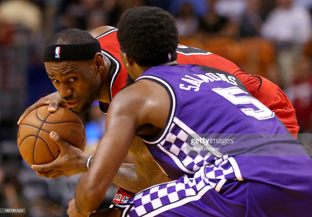 LeBron James of the Miami Heat is guarded by John Salmons of the Sacramento Kings during a game at American Airlines Arena on February 26 2013 in...