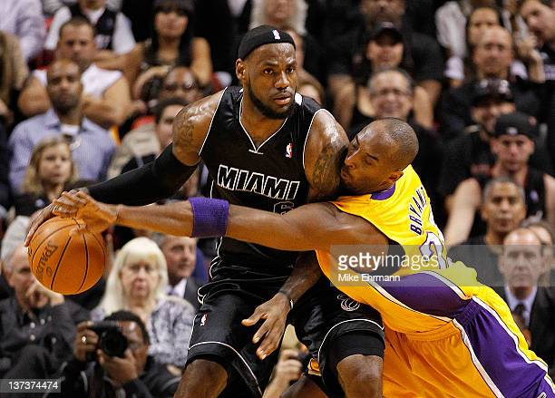 LeBron James of the Miami Heat is guarded by Kobe Bryant of the Los Angeles Lakers during a game at American Airlines Arena on January 19 2012 in...