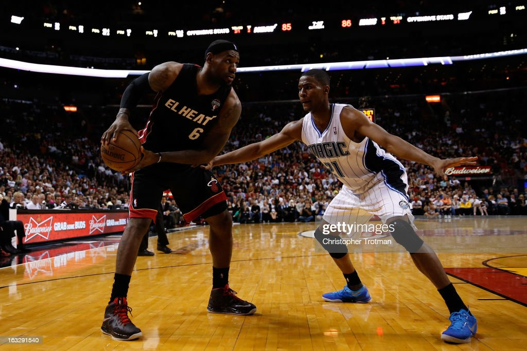 LeBron James #6 of the Miami Heat is guarded by Moe Harkless #21 of the Orlando Magic at American Airlines Arena on March 6, 2013 in Miami, Florida.