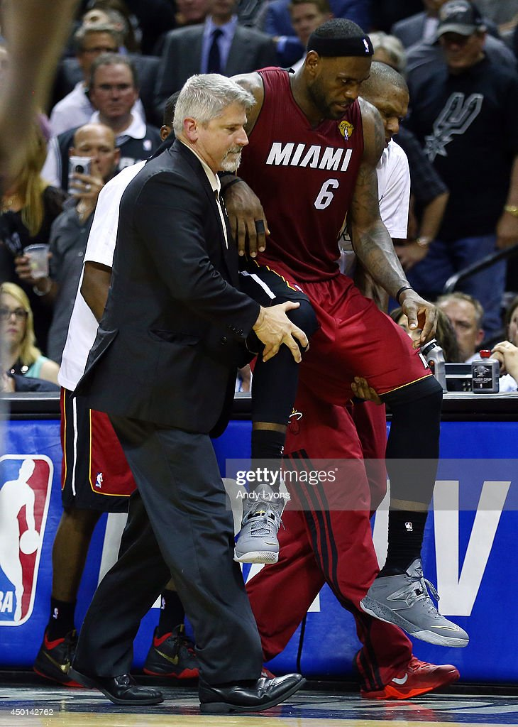 <a gi-track='captionPersonalityLinkClicked' href=/galleries/search?phrase=LeBron+James&family=editorial&specificpeople=201474 ng-click='$event.stopPropagation()'>LeBron James</a> #6 of the Miami Heat is helped off the court after cramping up against the San Antonio Spurs during Game One of the 2014 NBA Finals at the AT&T Center on June 5, 2014 in San Antonio, Texas.
