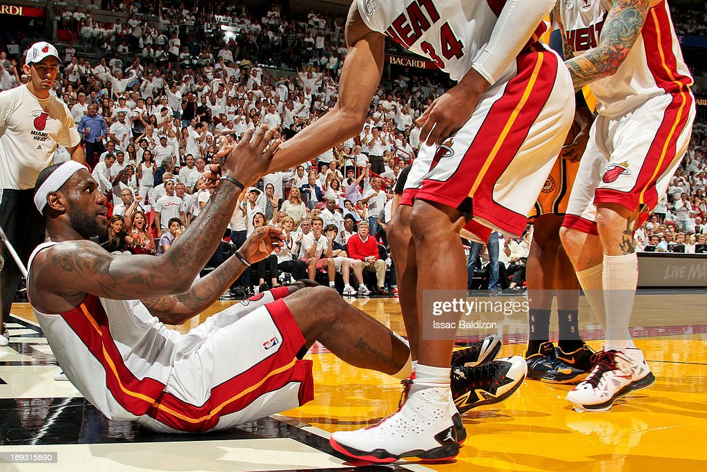 LeBron James #6 of the Miami Heat is helped up by teammates while playing the Indiana Pacers in Game One of the Eastern Conference Finals during the 2013 NBA Playoffs on May 22, 2013 at American Airlines Arena in Miami, Florida.