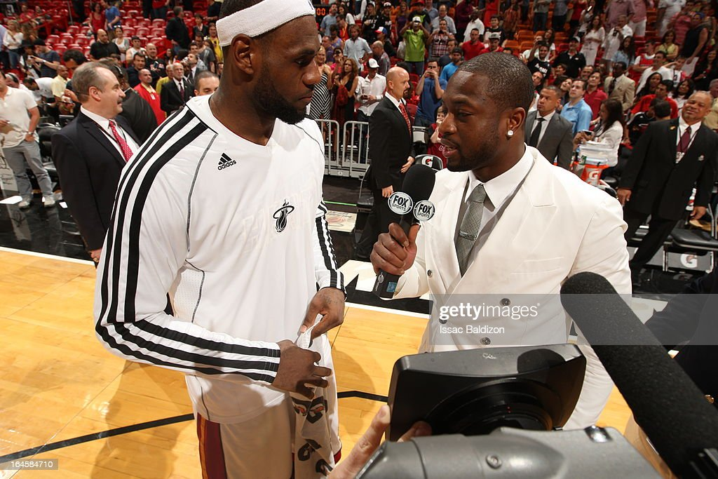 <a gi-track='captionPersonalityLinkClicked' href=/galleries/search?phrase=LeBron+James&family=editorial&specificpeople=201474 ng-click='$event.stopPropagation()'>LeBron James</a> #6 of the Miami Heat is interviewed with <a gi-track='captionPersonalityLinkClicked' href=/galleries/search?phrase=Dwyane+Wade&family=editorial&specificpeople=201481 ng-click='$event.stopPropagation()'>Dwyane Wade</a> #3 of the Miami Heat after a game between the Charlotte Bobcats and the Miami Heat on March 24, 2013 at American Airlines Arena in Miami, Florida.