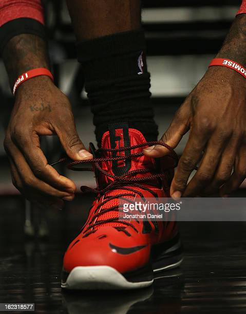 LeBron James of the Miami Heat laces up his shoes before a game against the Chicago Bulls at the United Center on February 21 2013 in Chicago...