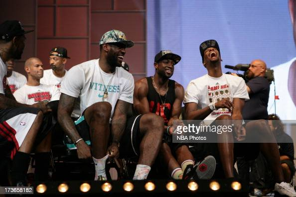 LeBron James of the Miami Heat laughs with teammates Chris Bosh and Dwyane Wade during the rally for seasonticket holders at the American Airlines...
