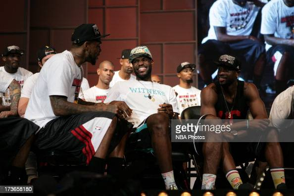 LeBron James of the Miami Heat laughs with teammates Udonis Haslem and Dwyane Wade during the rally for seasonticket holders at the American Airlines...