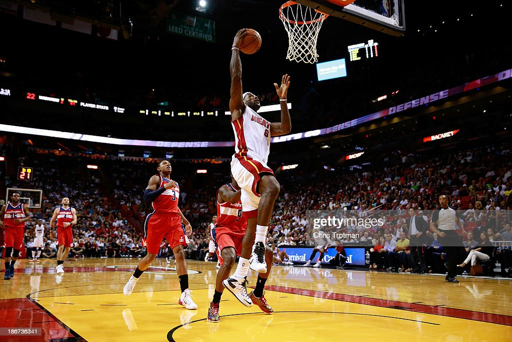 <a gi-track='captionPersonalityLinkClicked' href=/galleries/search?phrase=LeBron+James&family=editorial&specificpeople=201474 ng-click='$event.stopPropagation()'>LeBron James</a> #6 of the Miami Heat lays the ball up in front of <a gi-track='captionPersonalityLinkClicked' href=/galleries/search?phrase=Bradley+Beal&family=editorial&specificpeople=7640439 ng-click='$event.stopPropagation()'>Bradley Beal</a> #3 of the Washington Wizards and Martell Webster #9 of the Washington Wizards at American Airlines Arena on November 3, 2013 in Miami, Florida.