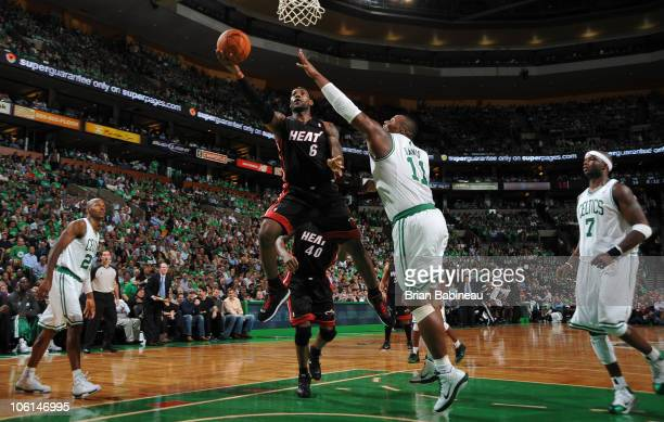 LeBron James of the Miami Heat lays the ball up in the lane against Glen Davis of the Boston Celtics on October 26 2010 at the TD Garden in Boston...