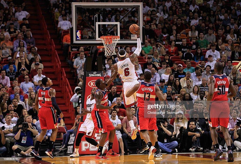 LeBron James #6 of the Miami Heat lays the ball up to the basket as Martell Webster #9 of the Washington Wizards looks on at American Airlines Arena on January 6, 2013 in Miami, Florida.