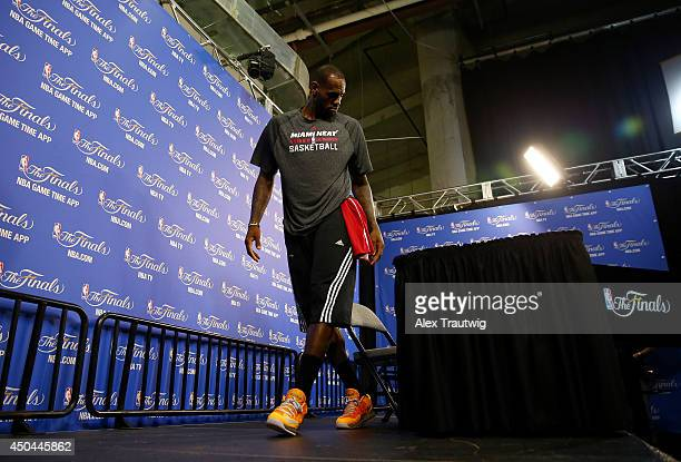LeBron James of the Miami Heat leaves after speaking to the media on an off day following Game Three of the 2014 NBA Finals against the San Antonio...