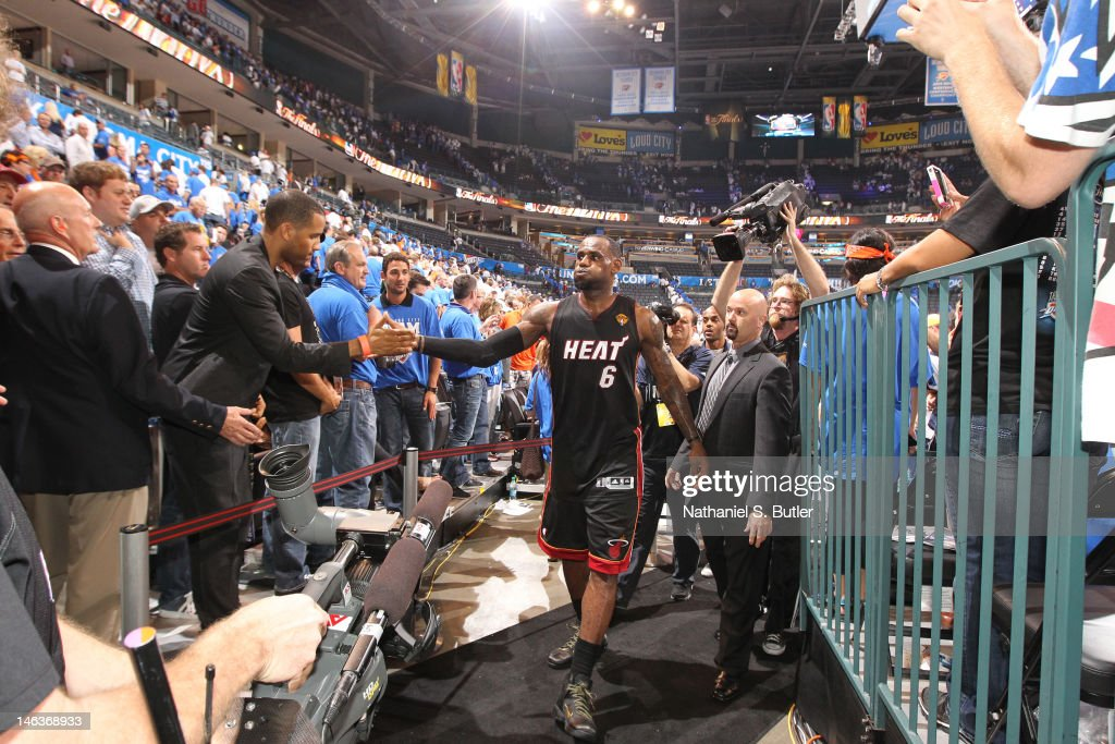 <a gi-track='captionPersonalityLinkClicked' href=/galleries/search?phrase=LeBron+James&family=editorial&specificpeople=201474 ng-click='$event.stopPropagation()'>LeBron James</a> #6 of the Miami Heat leaving the court after defeating the Oklahoma City Thunder in Game Two of the 2012 NBA Finals at Chesapeake Energy Arena on June 14, 2012 in Oklahoma City, Oklahoma.