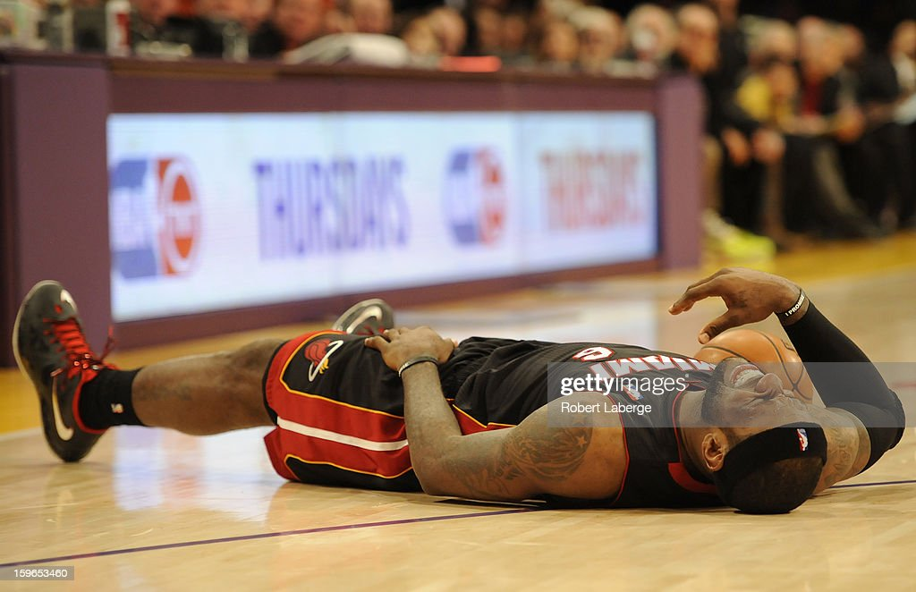 Lebron James #6 of the Miami Heat lies on the court after falling during the game against the Los Angeles Lakers at Staples Center on January 17, 2013 in Los Angeles, California.