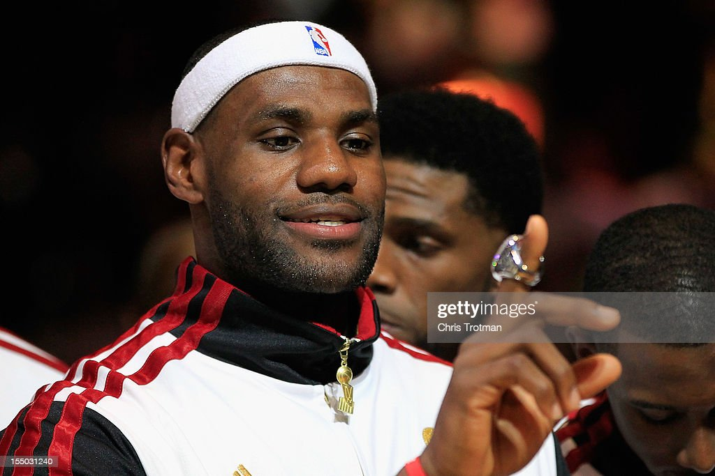 LeBron James #6 of the Miami Heat looks at his 2012 NBA Championship ring following a ceremony prior to the game against the Boston Celtics at American Airlines Arena on October 30, 2012 in Miami, Florida.