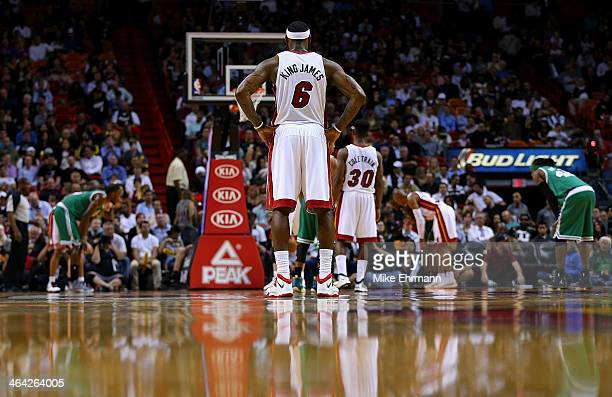 LeBron James of the Miami Heat looks on during a game against the Boston Celtics at AmericanAirlines Arena on January 21 2014 in Miami Florida NOTE...