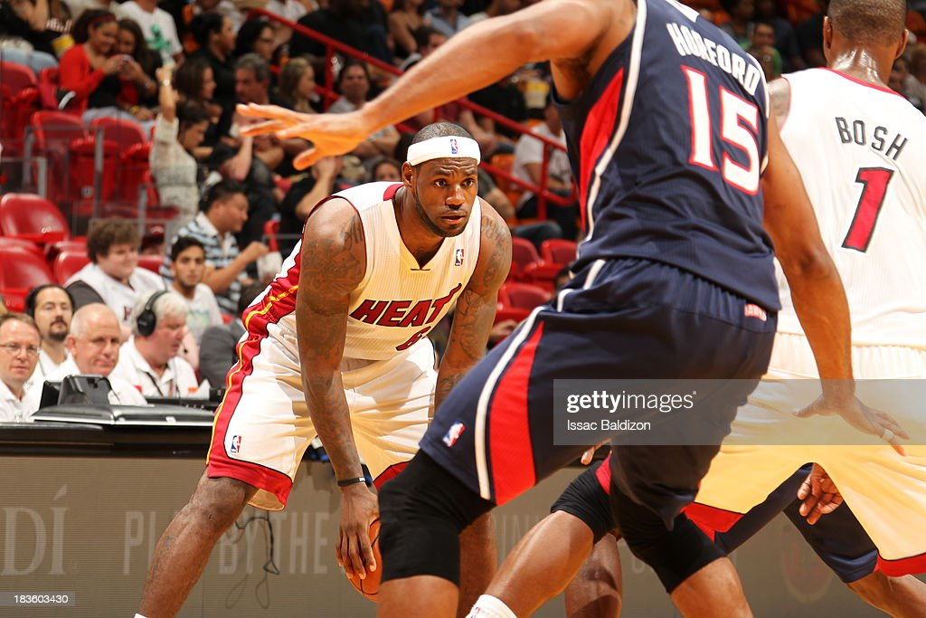 <a gi-track='captionPersonalityLinkClicked' href=/galleries/search?phrase=LeBron+James&family=editorial&specificpeople=201474 ng-click='$event.stopPropagation()'>LeBron James</a> #6 of the Miami Heat looks to an open man against the Atlanta Hawks during a game on October 7, 2013 at American Airlines Arena in Miami, Florida.