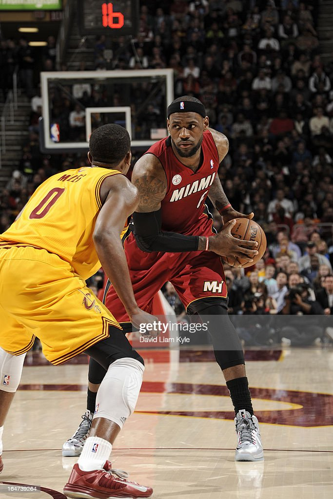 <a gi-track='captionPersonalityLinkClicked' href=/galleries/search?phrase=LeBron+James&family=editorial&specificpeople=201474 ng-click='$event.stopPropagation()'>LeBron James</a> #6 of the Miami Heat looks to drive to the basket against the Cleveland Cavaliers at The Quicken Loans Arena on March 20, 2013 in Cleveland, Ohio.
