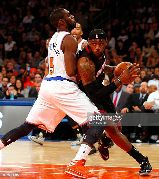 LeBron James of the Miami Heat looks to get past Tim Hardaway Jr #5 of the New York Knicks at Madison Square Garden on February 1 2014 in New York...