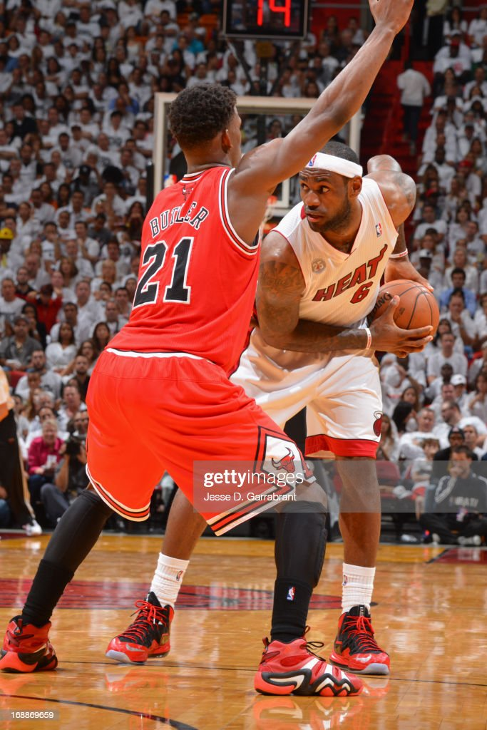 <a gi-track='captionPersonalityLinkClicked' href=/galleries/search?phrase=LeBron+James&family=editorial&specificpeople=201474 ng-click='$event.stopPropagation()'>LeBron James</a> #6 of the Miami Heat looks to make a move against <a gi-track='captionPersonalityLinkClicked' href=/galleries/search?phrase=Jimmy+Butler+-+Basketballer&family=editorial&specificpeople=9860567 ng-click='$event.stopPropagation()'>Jimmy Butler</a> #21 of the Chicago Bulls in Game Five of the Eastern Conference Semifinals during the 2013 NBA Playoffs on May 15, 2013 at American Airlines Arena in Miami, Florida.