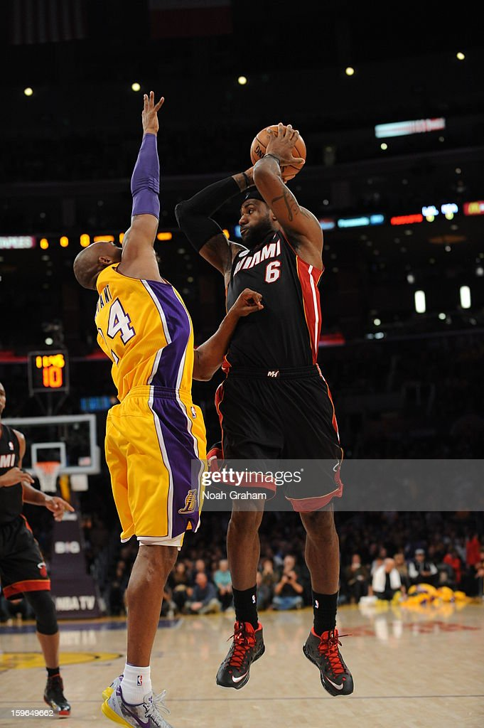 LeBron James #6 of the Miami Heat looks to pass against Kobe Bryant #24 of the Los Angeles Lakers at Staples Center on January 15, 2013 in Los Angeles, California.