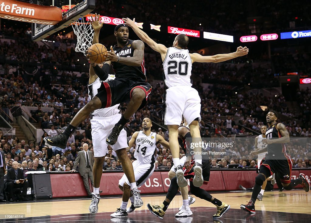 LeBron James #6 of the Miami Heat looks to pass around Manu Ginobili #20 of the San Antonio Spurs in the fourth quarter during Game Four of the 2013 NBA Finals at the AT&T Center on June 13, 2013 in San Antonio, Texas.