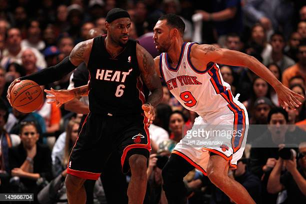 LeBron James of the Miami Heat looks to pass in the first half against Jared Jeffries of the New York Knicks in Game Four of the Eastern Conference...
