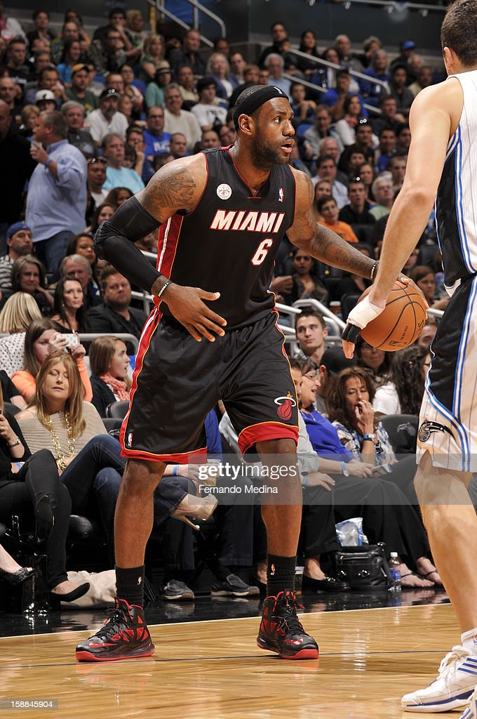 LeBron James #6 of the Miami Heat looks to pass the ball against the Orlando Magic during the game on December 31, 2012 at Amway Center in Orlando, Florida.