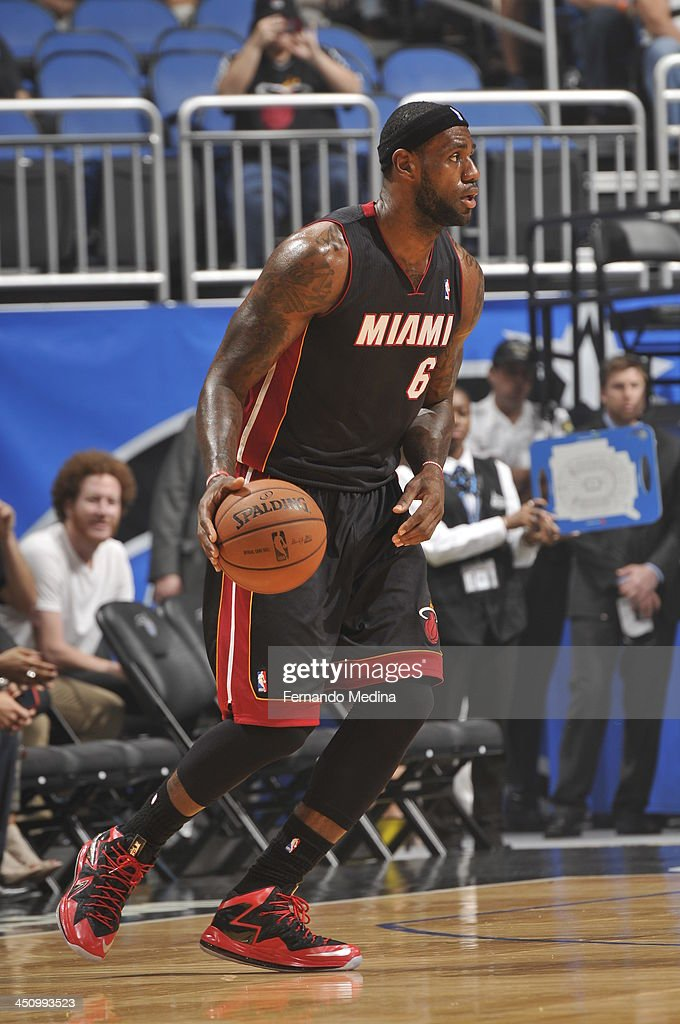 <a gi-track='captionPersonalityLinkClicked' href=/galleries/search?phrase=LeBron+James&family=editorial&specificpeople=201474 ng-click='$event.stopPropagation()'>LeBron James</a> #6 of the Miami Heat looks to pass the ball against the Orlando Magic during the game on November 20, 2013 at Amway Center in Orlando, Florida.