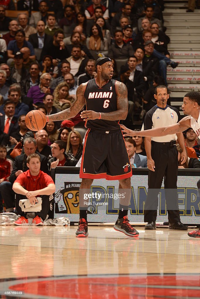 <a gi-track='captionPersonalityLinkClicked' href=/galleries/search?phrase=LeBron+James&family=editorial&specificpeople=201474 ng-click='$event.stopPropagation()'>LeBron James</a> #6 of the Miami Heat looks to pass the ball against the Toronto Raptors during the game on November 5, 2013 at the Air Canada Centre in Toronto, Ontario, Canada.