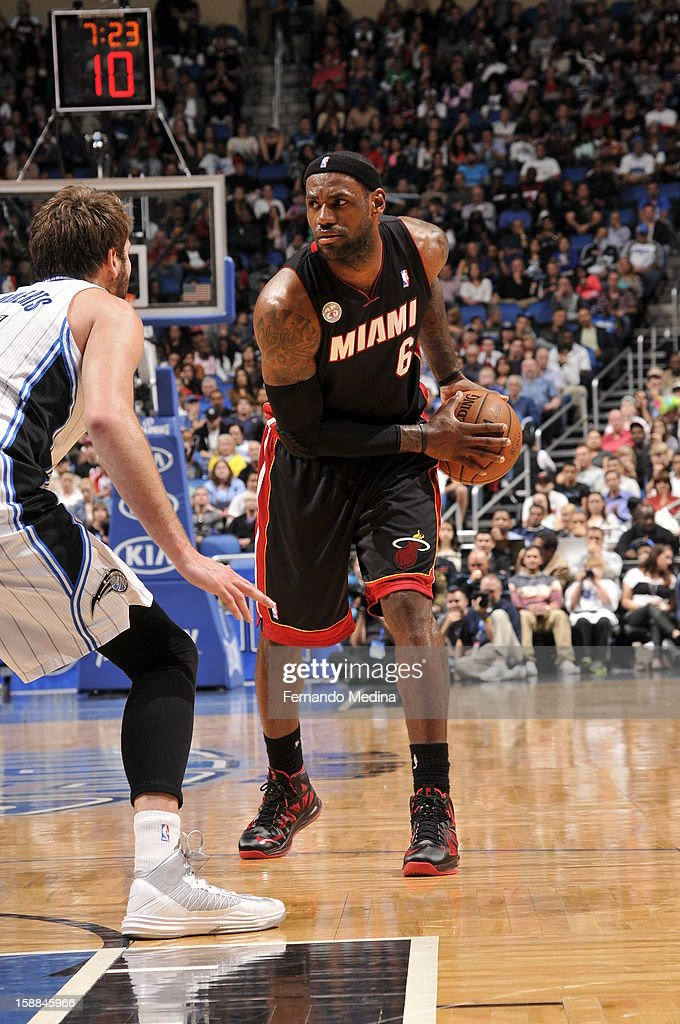 LeBron James #6 of the Miami Heat looks to pass the ball down low against the Orlando Magic during the game on December 31, 2012 at Amway Center in Orlando, Florida.