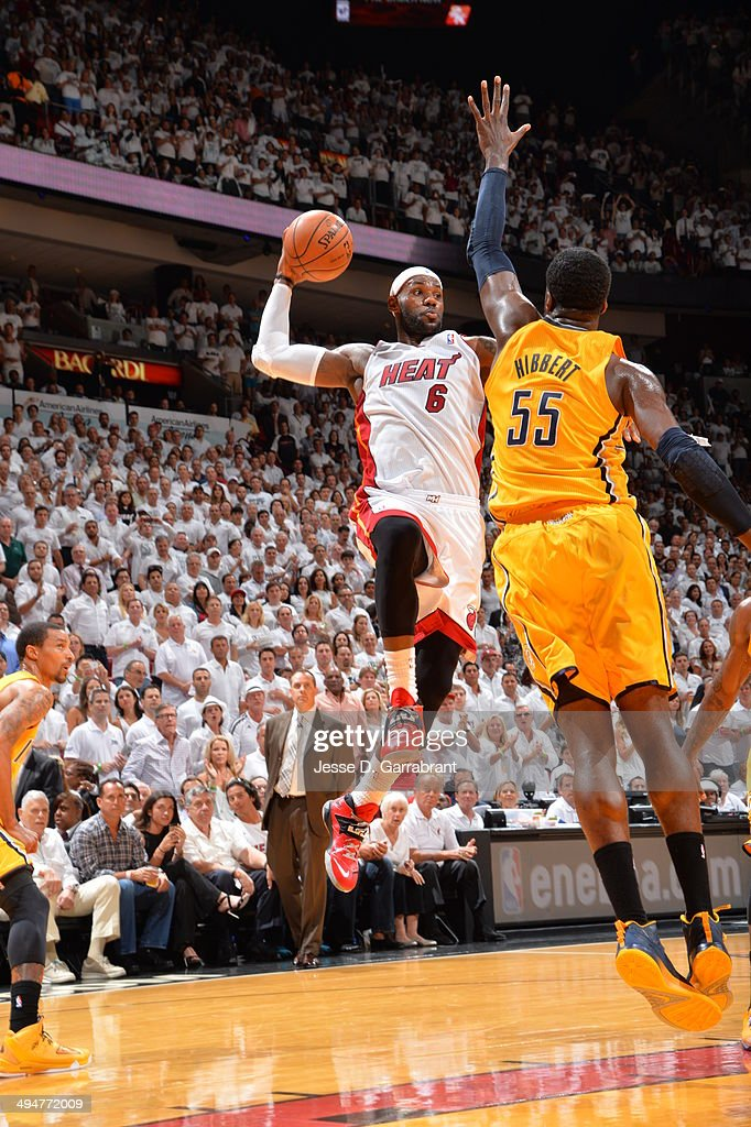 LeBron James #6 of the Miami Heat looks to pass the ball in mid-air against the Indiana Pacers in Game Six of the Eastern Conference Finals during the 2014 NBA Playoffs on May 30, 2014 in Miami, Fl.