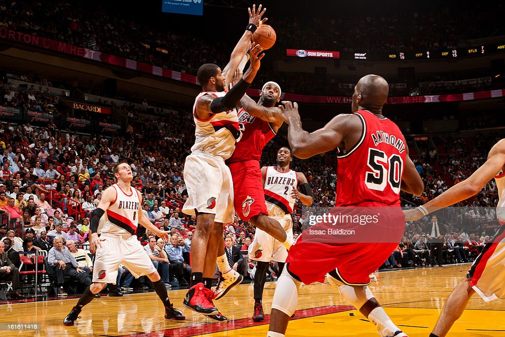 <a gi-track='captionPersonalityLinkClicked' href=/galleries/search?phrase=LeBron+James&family=editorial&specificpeople=201474 ng-click='$event.stopPropagation()'>LeBron James</a> #6 of the Miami Heat looks to pass the ball in the lane against <a gi-track='captionPersonalityLinkClicked' href=/galleries/search?phrase=LaMarcus+Aldridge&family=editorial&specificpeople=453277 ng-click='$event.stopPropagation()'>LaMarcus Aldridge</a> #12 of the Portland Trail Blazers on February 12, 2013 at American Airlines Arena in Miami, Florida.