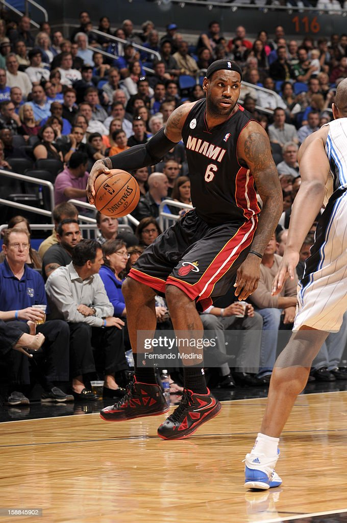 LeBron James #6 of the Miami Heat looks to pass the ball to a teammate against the Orlando Magic during the game on December 31, 2012 at Amway Center in Orlando, Florida.