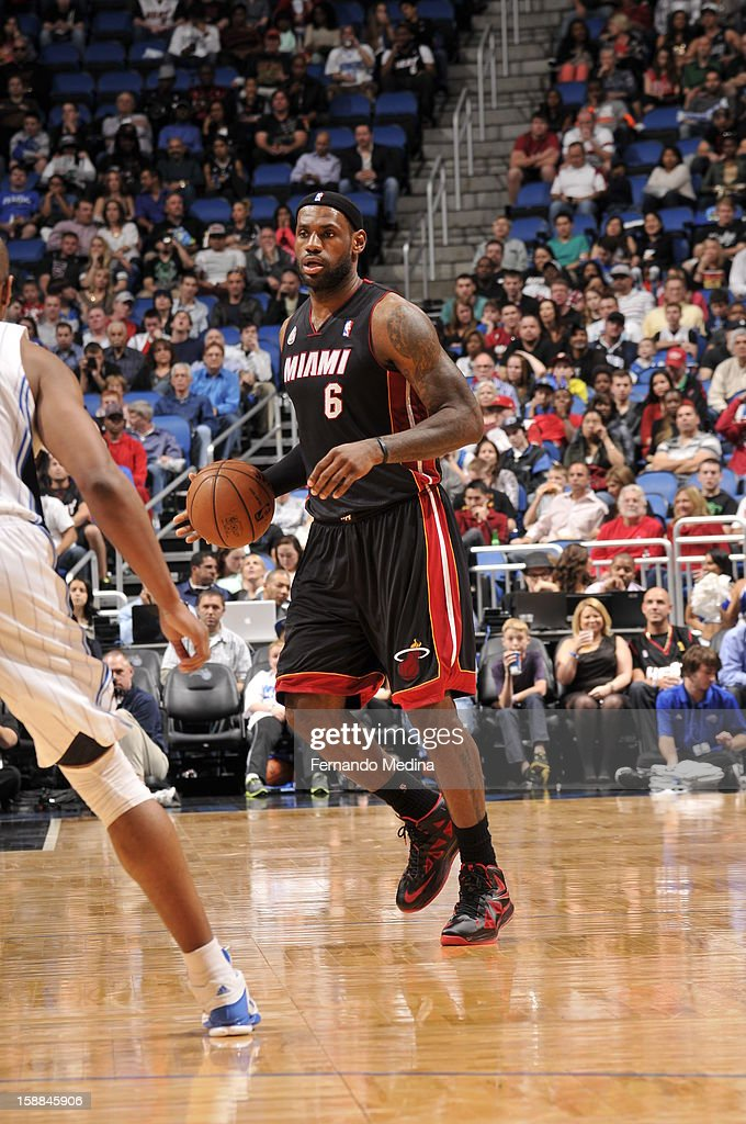 LeBron James #6 of the Miami Heat looks to pass while dribbling the ball against the Orlando Magic during the game on December 31, 2012 at Amway Center in Orlando, Florida.
