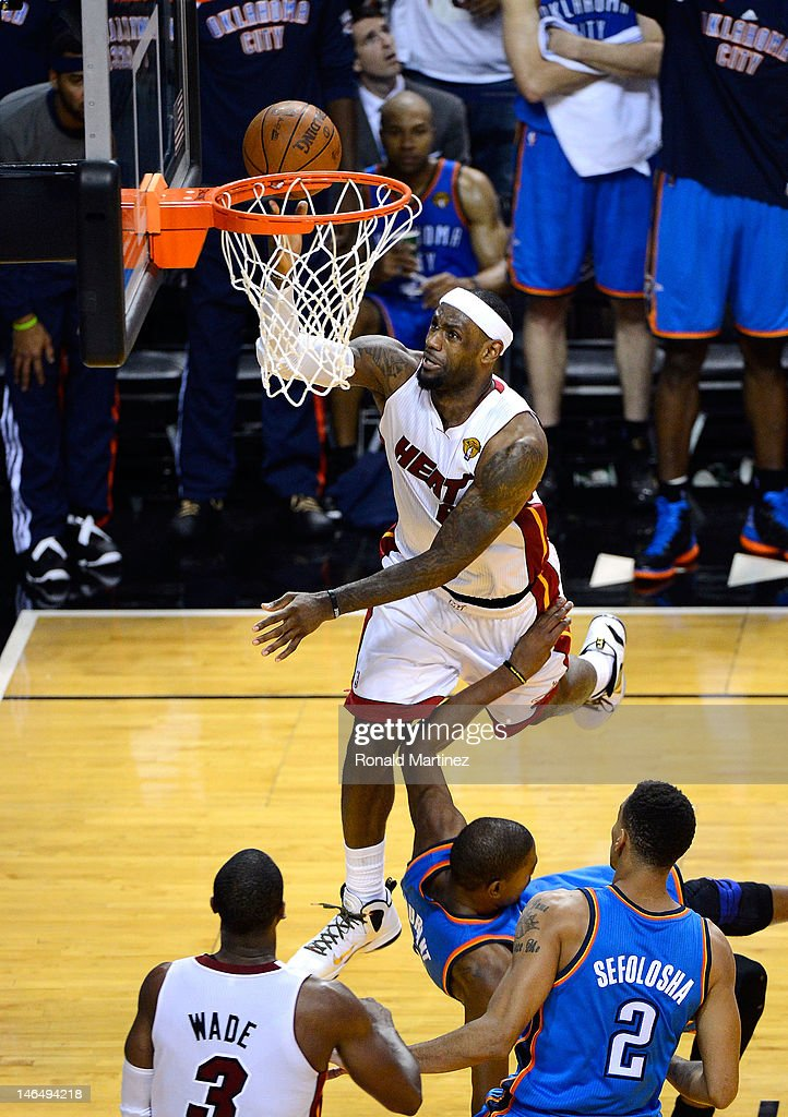 <a gi-track='captionPersonalityLinkClicked' href=/galleries/search?phrase=LeBron+James&family=editorial&specificpeople=201474 ng-click='$event.stopPropagation()'>LeBron James</a> #6 of the Miami Heat makes a basket in the fourth quarter against <a gi-track='captionPersonalityLinkClicked' href=/galleries/search?phrase=Kevin+Durant&family=editorial&specificpeople=3847329 ng-click='$event.stopPropagation()'>Kevin Durant</a> #35 of the Oklahoma City Thunder in Game Three of the 2012 NBA Finals on June 17, 2012 at American Airlines Arena in Miami, Florida.