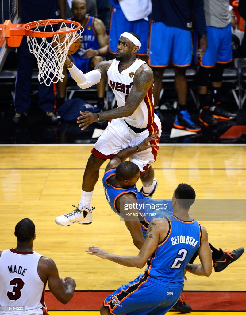 LeBron James #6 of the Miami Heat makes a basket in the fourth quarter against Kevin Durant #35 of the Oklahoma City Thunder in Game Three of the 2012 NBA Finals on June 17, 2012 at American Airlines Arena in Miami, Florida.