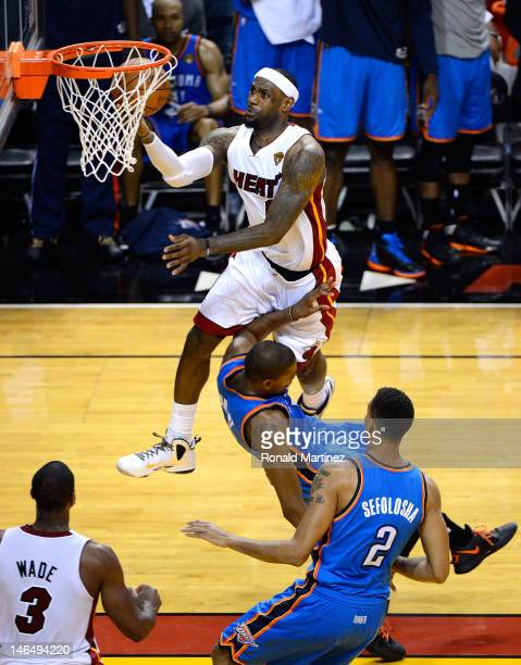 LeBron James of the Miami Heat makes a basket in the fourth quarter against Kevin Durant of the Oklahoma City Thunder in Game Three of the 2012 NBA...