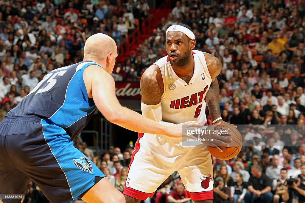 LeBron James #6 of the Miami Heat makes a move against Chris Kaman #35 of the Dallas Mavericks on January 2, 2013 at American Airlines Arena in Miami, Florida.