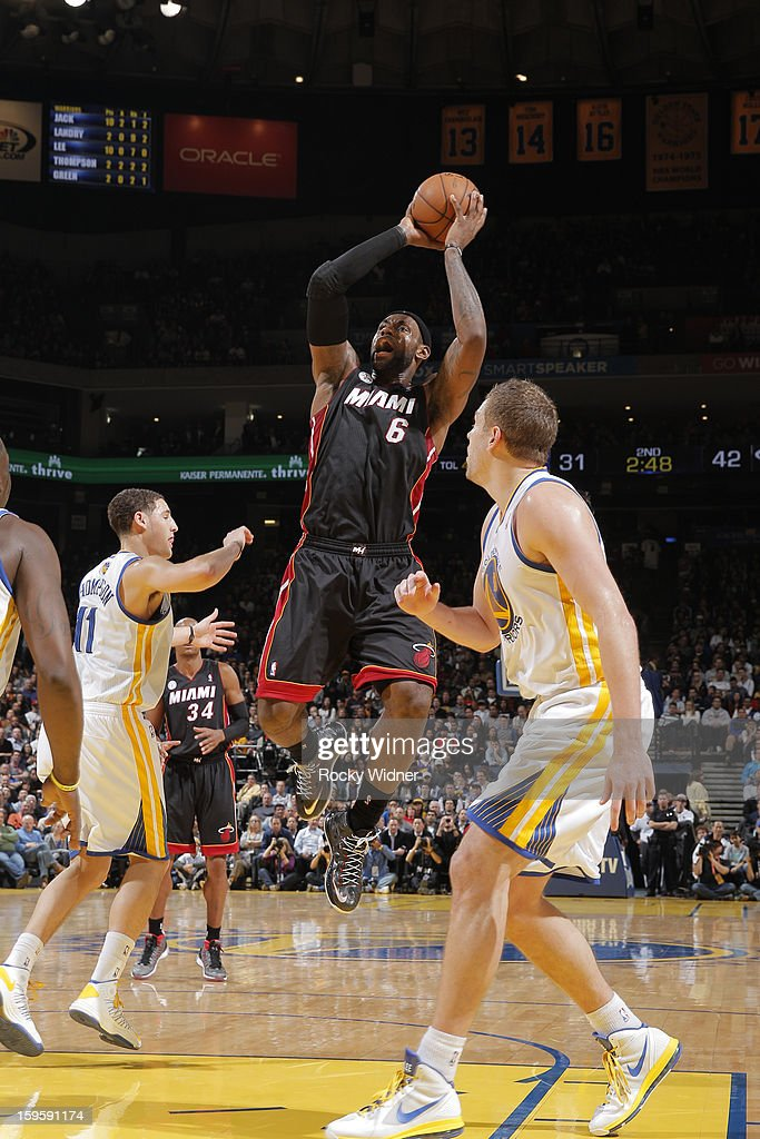 <a gi-track='captionPersonalityLinkClicked' href=/galleries/search?phrase=LeBron+James&family=editorial&specificpeople=201474 ng-click='$event.stopPropagation()'>LeBron James</a> #6 of the Miami Heat makes a shot, passing the 20,000 point career milestone, during a game against the Golden State Warriors on January 16, 2013 at Oracle Arena in Oakland, California.
