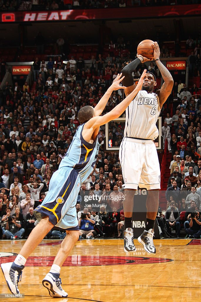 LeBron James #6 of the Miami Heat makes a three-pointer in the fourth quarter against Tayshaun Prince #21 of the Memphis Grizzlies on March 1, 2013 at American Airlines Arena in Miami, Florida.