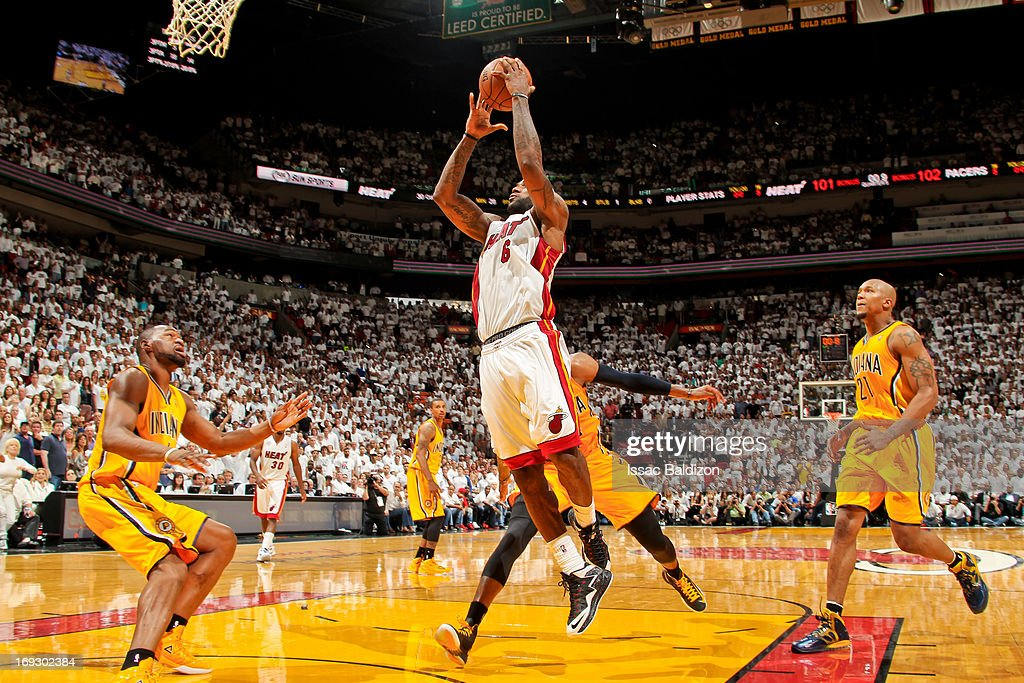 LeBron James #6 of the Miami Heat makes the game winning layup in overtime against the Indiana Pacers in Game One of the Eastern Conference Finals during the 2013 NBA Playoffs on May 22, 2013 at American Airlines Arena in Miami, Florida.