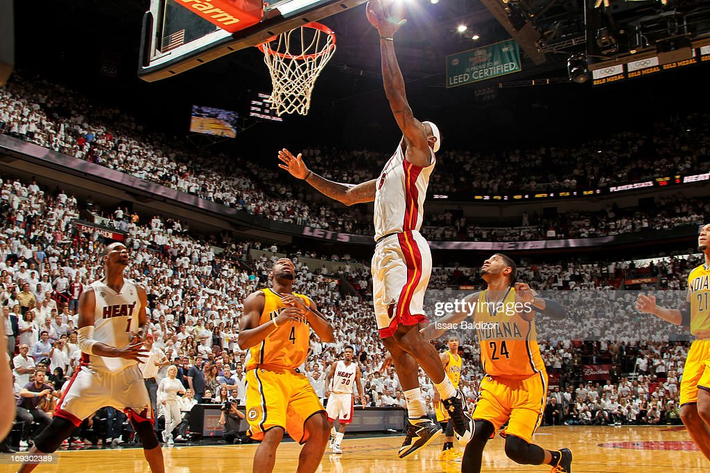 <a gi-track='captionPersonalityLinkClicked' href=/galleries/search?phrase=LeBron+James&family=editorial&specificpeople=201474 ng-click='$event.stopPropagation()'>LeBron James</a> #6 of the Miami Heat makes the game winning layup in overtime against the Indiana Pacers in Game One of the Eastern Conference Finals during the 2013 NBA Playoffs on May 22, 2013 at American Airlines Arena in Miami, Florida.