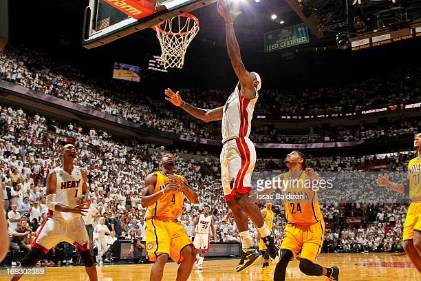 LeBron James of the Miami Heat makes the game winning layup in overtime against the Indiana Pacers in Game One of the Eastern Conference Finals...