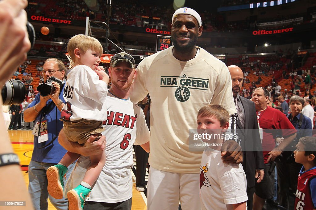 <a gi-track='captionPersonalityLinkClicked' href=/galleries/search?phrase=LeBron+James&family=editorial&specificpeople=201474 ng-click='$event.stopPropagation()'>LeBron James</a> #6 of the Miami Heat meets Cayden And Conner Long, Sports Illustrated's Sportkids of the Year, during a game between the Philadelphia 76ers and the Miami Heat on April 6, 2013 at American Airlines Arena in Miami, Florida.